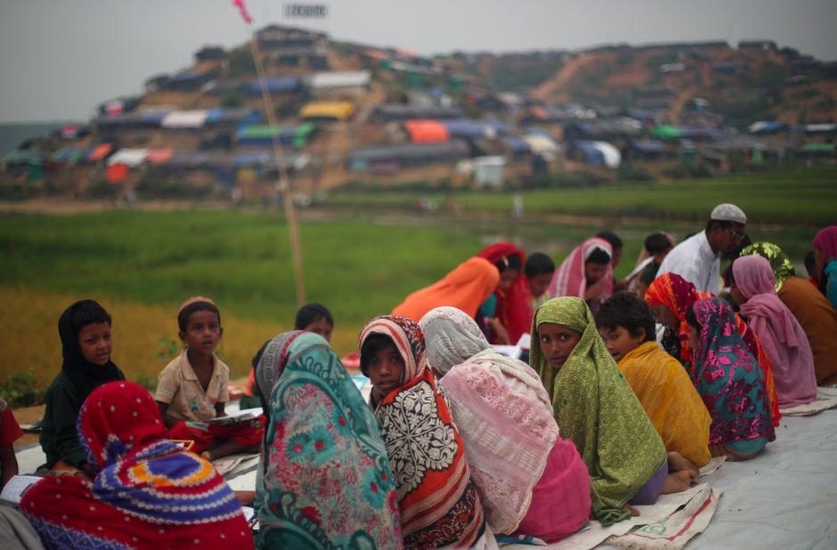 Rohingya refugee children attend a Quran reading lesson outside of a mosque in Palong Khali refugee camp near Cox's Bazar, Bangladesh, October 30, 2017. REUTERS/Hannah McKay
